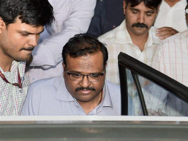 Sameer Bhujbal, nephew of NCP leader Chhagan Bhujbal, being taken to the Sessions Court in Mumbai on Tuesday.