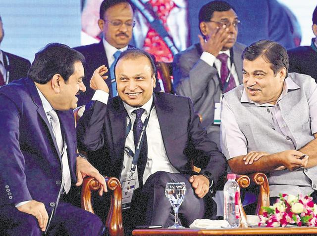 From left: Adani Group chairman Gautam Adani, Reliance Group chairman Anil Ambani, and road, transport and highways minister Nitin Gadkari share a light moment at the Karnataka investment summit.