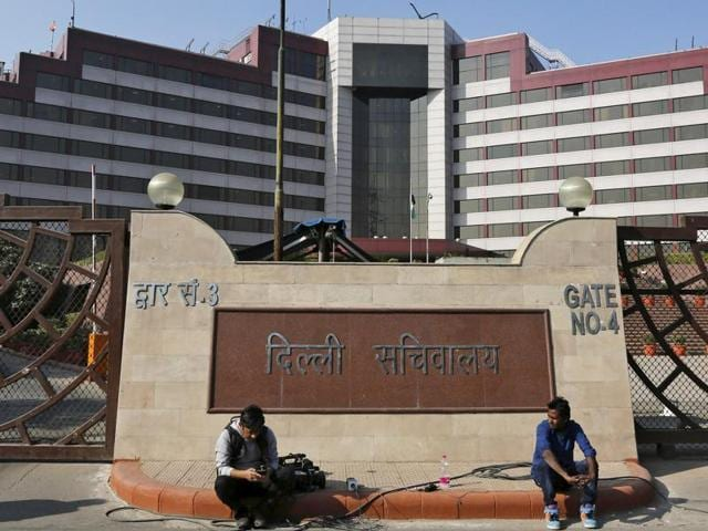 Media crew members sit outside the Delhi Secretariat building which houses the offices of the state Chief Minister Arvind Kejriwal and other senior officials.