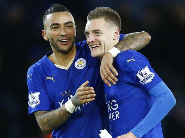 Leicester City's Jamie Vardy celebrates with Danny Simpson after the game.