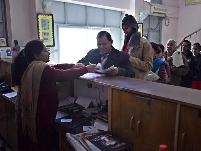 Parents' queue at a school for filling nursery admission forms  in New Delhi.