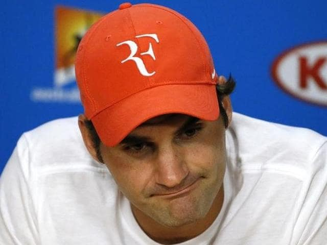 Switzerland's Roger Federer reacts during a news conference.