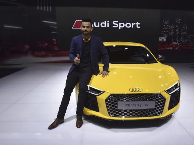 Virat Kohli poses next to Audi R8v10 Plus during its launch at Auto Expo 2016 at Greater Noida.