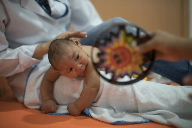Three-month-old Daniel, who was born with microcephaly, undergoes physical therapy at the Altino Ventura foundation in Recife, Brazil.