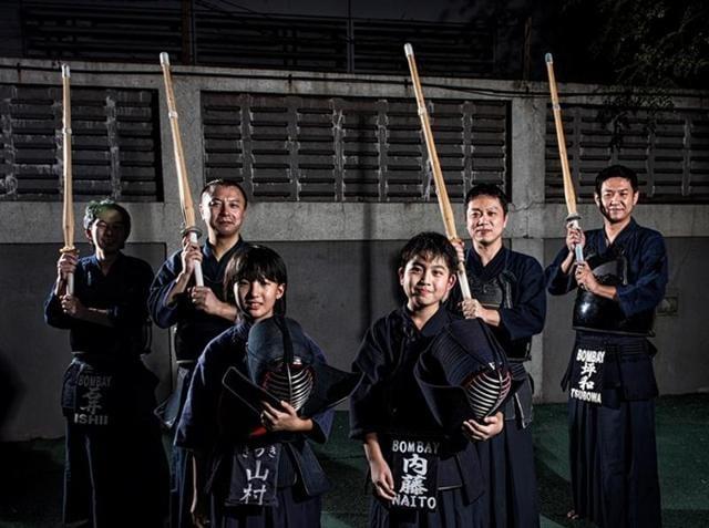 Members of the Mumbai Kendo Club with bamboo swords