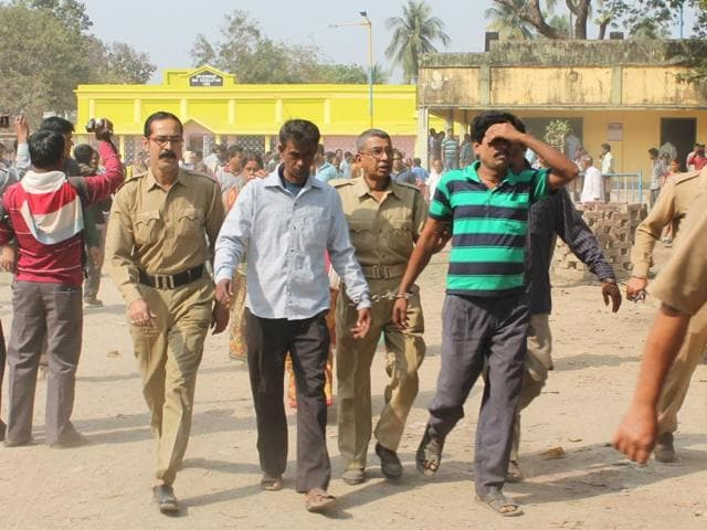 Police officials with two convicts in the murder case in Nadia.