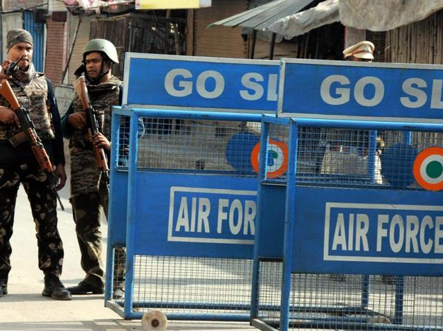 File photo of soldiers keeping guard at the perimeter fence of the Indian Air Force base in Pathankot.