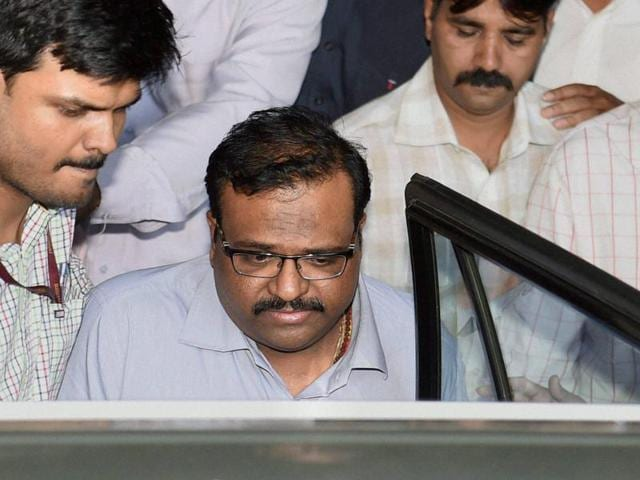 Sameer Bhujbal, nephew of NCP leader Chhagan Bhujbal, being taken to the Sessions Court in Mumbai on Tuesday. Sameer has been arrested by the Enforcement Directorate in connection with the Maharashtra Sadan scam case.