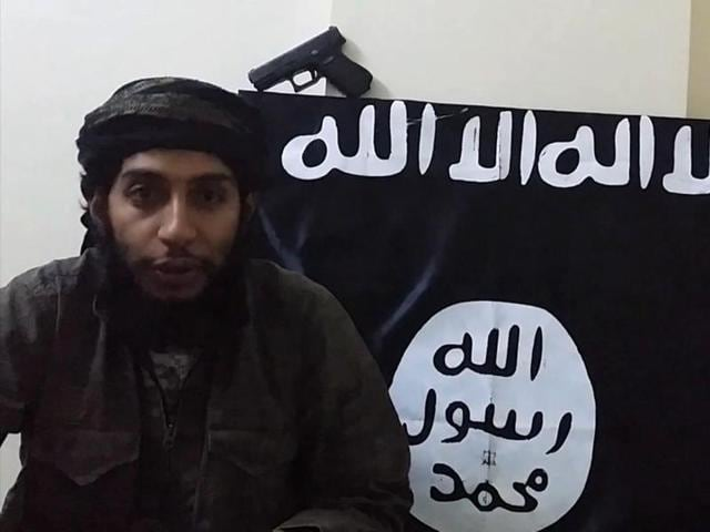 An image grab taken from a video released by the jihadist media arm al Hayat Media Centre purportedly shows suspected Paris attacks mastermind Abdelhamid Abaaoud speaking to the camera at an undisclosed location.