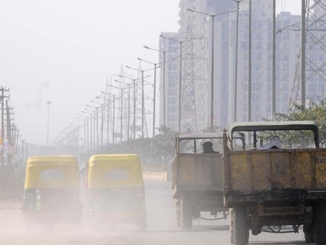 File photo of cyclists riding ride amidst morning smog in New Delhi. Air pollution has been listed as the top five avoidable causes of cancer in India by the government.