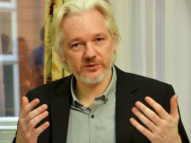 WikiLeaks founder Julian Assange gestures during a news conference at the Ecuadorian embassy in central London.