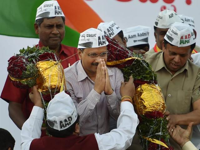 File photo of AAP volunteers with Delhi chief minister during a public rally.