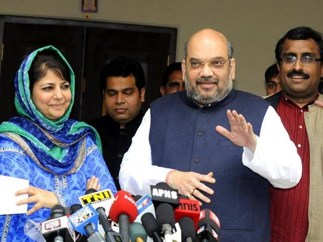 File photo of BJP president Amit Shah with PDP leader Mehbooba Mufti in New Delhi. Suspense over government formation continued in Jammu and Kashmir as PDP and BJP passed the buck on each other to end the political stalemate.