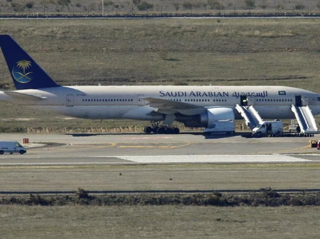 Saudi Arabian Airlines flight SVA 226 is isolated on the tarmac after its passengers and crew were evacuated following a bomb threat, at the Barajas airport in Madrid, Spain.