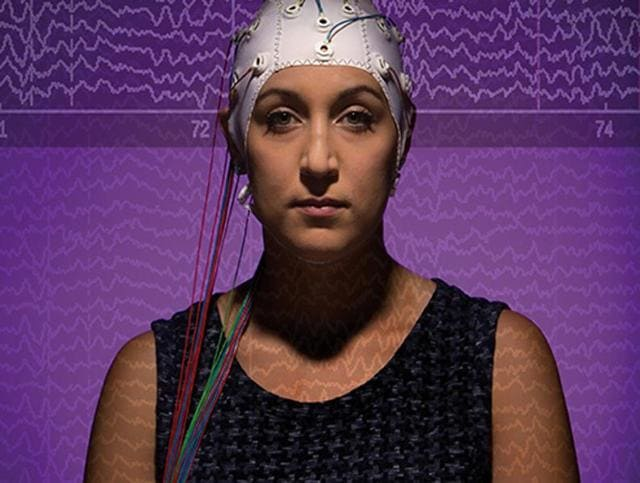 Photo illustration for a story published in Binghamton University Magazine shows a subject wearing a cap that can monitor brainwaves. Actual brain waves are shown in the background.