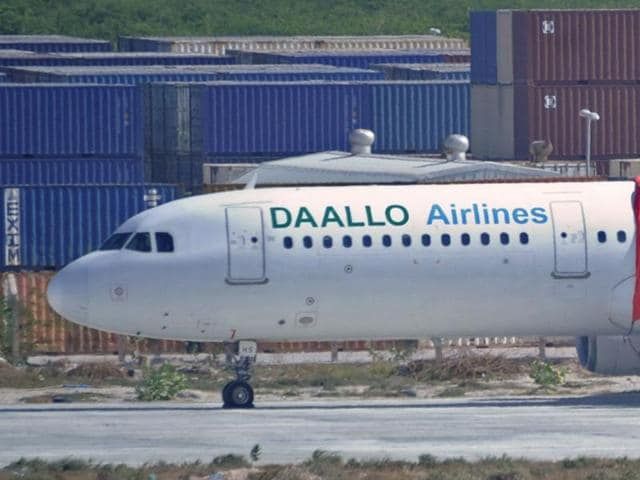 A picture taken on February 3, 2016 shows a plane operated by Daallo Airlines, after it made an emergency landing in Mogadishu following a blast.