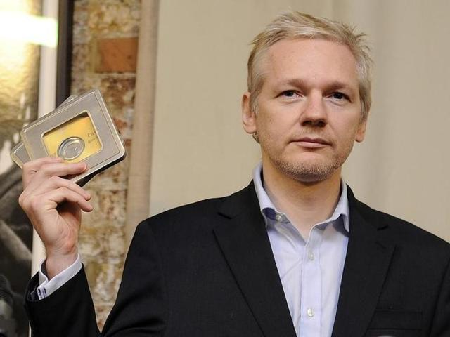 WikiLeaks founder Julian Assange (R) speaks as Ecuador's Foreign Affairs Minister Ricardo Patino listens, during a news conference at the Ecuadorian embassy in central London.