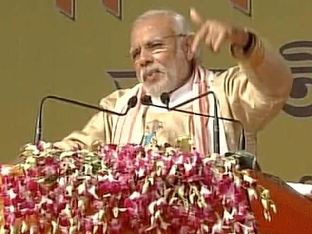 Prime Minister Narendra Modi addressing a public rally at Moran in Assam on Friday.(ANI)