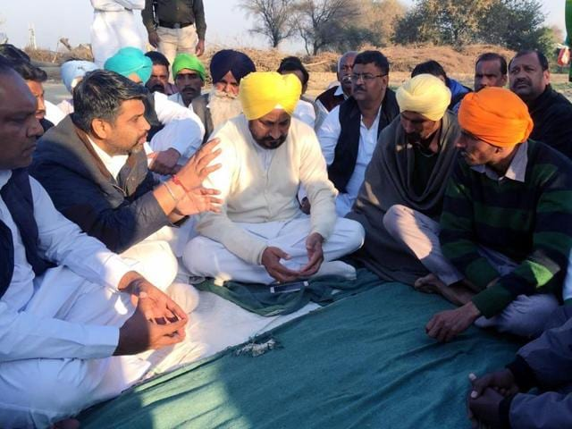 Congress Legislature Party leader Charanjit Singh Channi interacting with family members of farmer Babu Singh who recently committed suicide, at Jaga Ram Tirath village in Bathinda.