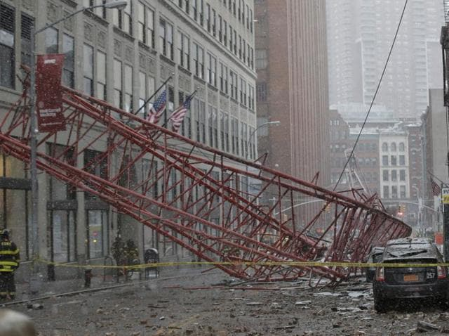 Emergency crews survey a massive construction crane collapse on a street in downtown Manhattan in New York.