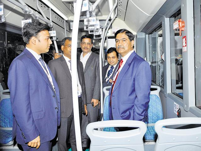 The CEO of Noida authority Rama Raman (right) inspects the bus.
