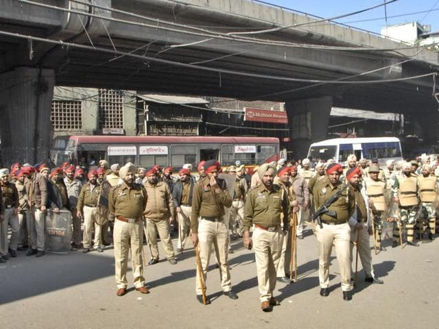 Police personnel deployed during a protest at Chaura Bazaar in Ludhiana on Thursday.