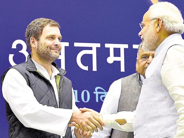 Congress vice president Rahul Gandhi shakes hands with Prime Minister Narendra Modi during a function at Vigyan Bhawan in New Delhi.