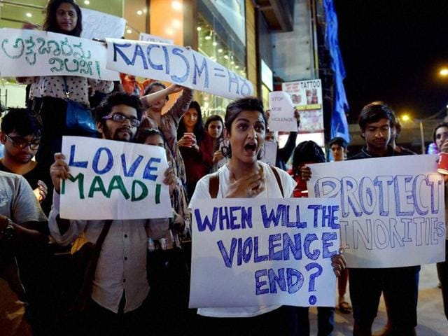 Students from different colleges hold placards and Candles during a protest against the attack on a Tanzanian Girl by a mob in Bengaluru on Thursday.