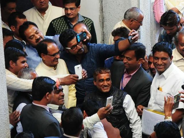 BJP workers click selfies with chief minister Shivraj Singh Chouhan at the party's state office in Bhopal on Thursday.