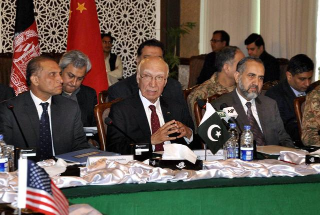In this handout photograph released by the Associated Press of Pakistan (APP), adviser to the Pakistan's Prime Minister on foreign affairs, Sartaj Aziz (C) chairs the third round of four-way peace talks with Afghanistan, US and Chinese delegates in Islamabad.