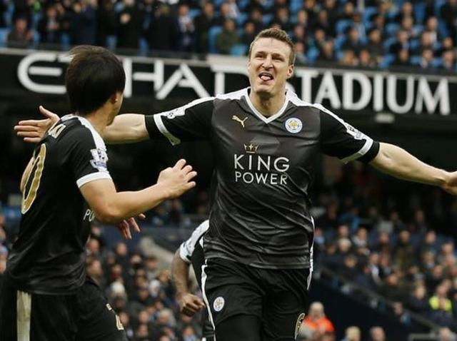 Leicester City's Robert Huth celebrates scoring their third goal as Manchester City players look dejected. EPL rivals City lost the match 3-1.