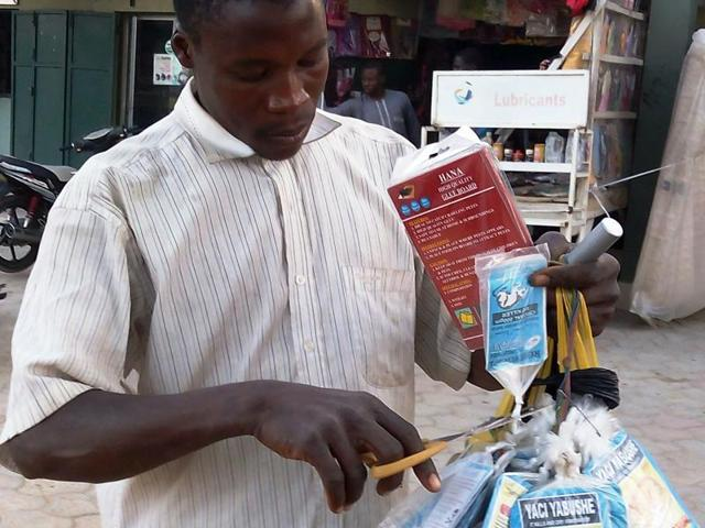 A vendor sells bags of rat poison in northern Nigeria's largest city of Kano on January 18, 2016. Sales of rat poison have taken off in Nigeria following an outbreak of Lassa fever that has left at least 100 people dead and sparked fears of contagion across the country.