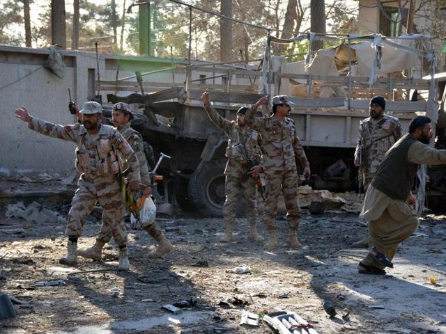 Pakistani paramilitary soldiers cordon off the site of a bomb explosion that targeted a security convoy in Quetta.