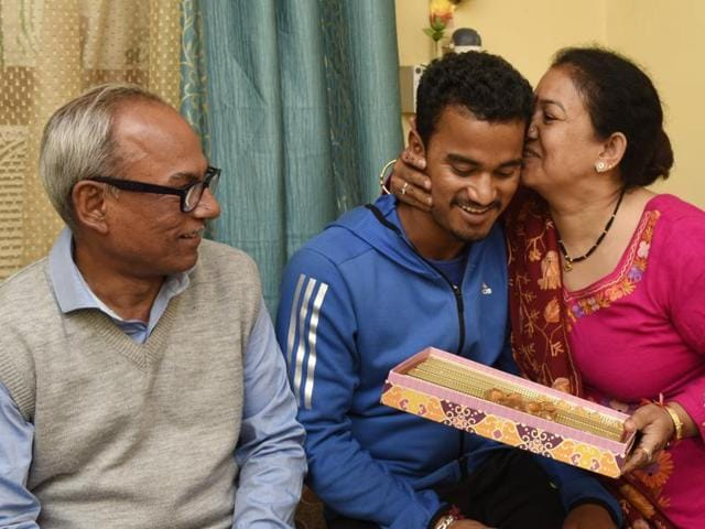 Pawan Negi with his parents after he was bought by Delhi Dare Devil Team for IPL season 2016 for 8.5 crores.