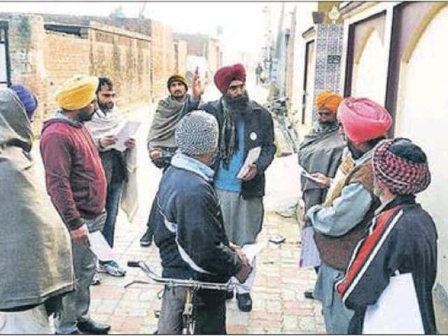 Independent candidate Sumail Singh Sidhu (centre) interacting with the people at Munda village of the Khadoor Sahib constituency on Saturday.