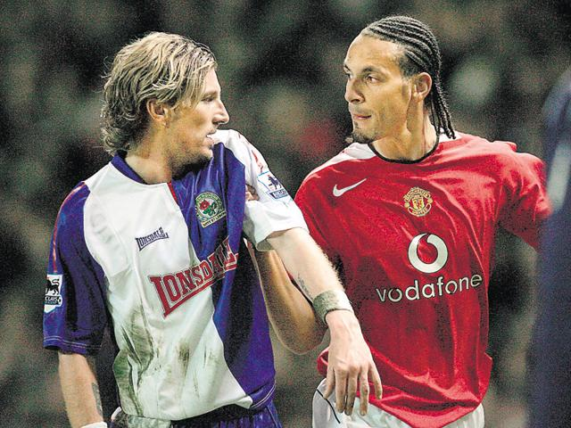 Robbie Savage (left) and Rio Ferdinand during a match between Blackburn Rovers and Manchester United in 2006.