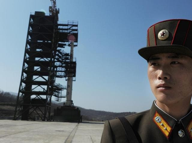 This file photo shows a North Korean soldier standing guard in front of an Unha-3 rocket at the Sohae Satellite Launch Station in Tongchang-Ri. North Korea launched a long-range rocket on February 7, 2016, violating UN resolutions.
