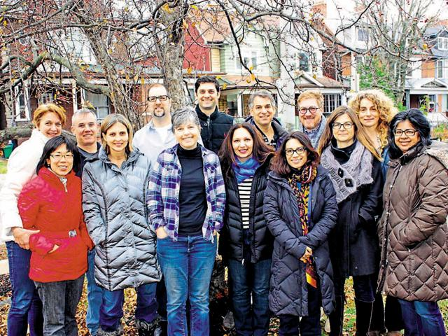 Henna Agha (front row centre) with members of the Toronto-based group privately sponsoring Syrian refugees.