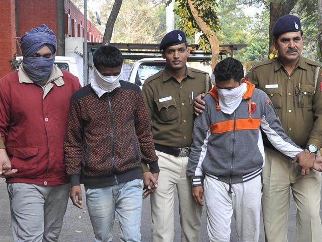The accused in police custody on Sunday.