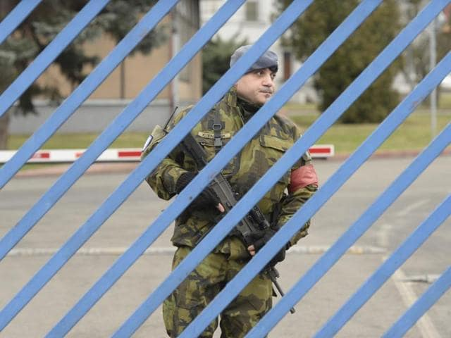 A soldier patrols at the military airport in Prague. The Czech government paid a $6-million ransom to secure the release of two women kidnapped by armed men in Pakistan.