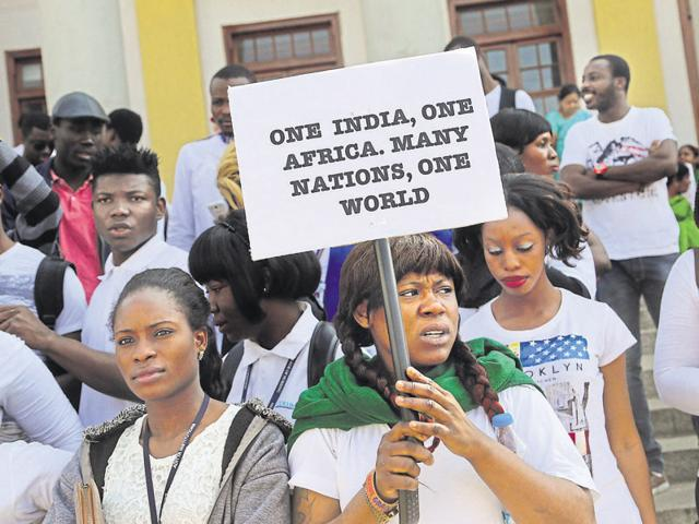 African students participate in a protest against the alleged assault of a Tanzanian woman in Bengaluru.