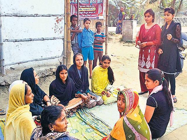Shazia and Afreen talking to village women during their drive to create awareness on gender bias and family planning.