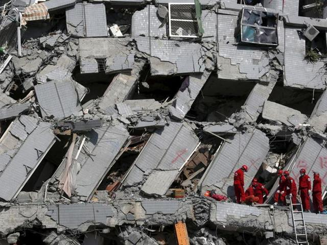 Rescue personnel work at the site where a 17-storey apartment building collapsed after an earthquake hit Tainan, southern Taiwan.