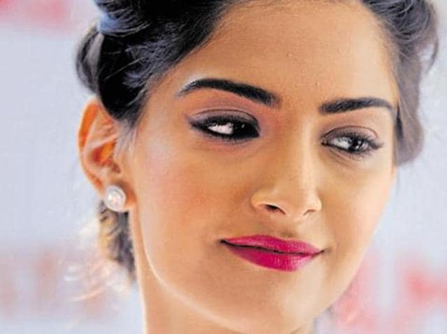 Sonam Kapoor poses for a photograph for a promotional event for Filmfare Glamour and Style Awards in Mumbai.