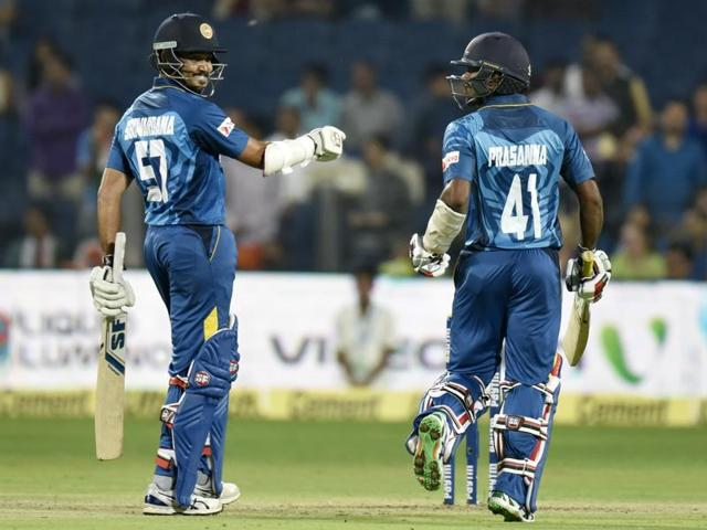 Sri Lankan players celebrate their victory against India during the first T20 international in Pune on February 9, 2016.