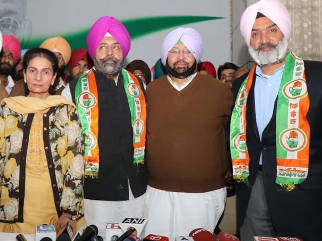 PPCC chief Captain Amarinder Singh and his wife Preneet Kaur with Deepinder Dhillon (right) and Harry Mann after the duo joined the Congress in Chandigarh on Monday.