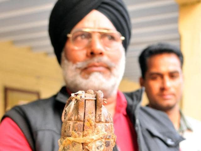 A member of the anti-sabotage team showing the hand grenade in Jalandhar on Monday.