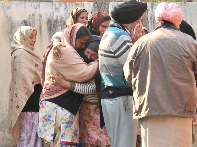 Relatives of the deceased at the civil hospital in Kapurthala on Monday.