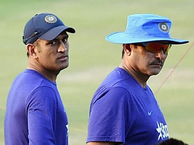 Team India Director Ravi Shastri and skipper MS Dhoni during a practice session ahead of the T20 match against Sri Lanka in Pune on Monday.