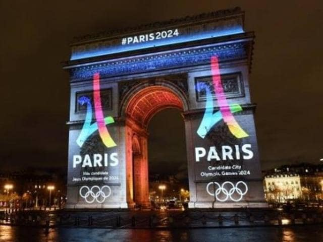 Paris unveiled its Eiffel Tower-shaped logo in a ceremony on the Champs Elysees.